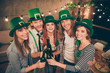 Leinwanddruck Bild - Close up photo company buddies hands raise beer bottles laugh laughter in bar pub celebrating funny funky carefree every year tradition st paddy day holiday weekend vacation free time leisure rejoice