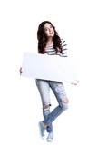 Beautiful young woman holding white blank board