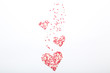 Quadro Heart shaped sprinkles on white background