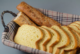 Pieces of baguette bread and slices of brioche in a breadbasket for breakfast