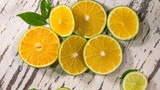 lemons and limes on wooden background
