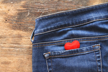 Small red heart in jeans pocket