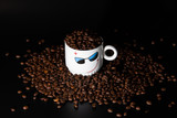 white cups with a pattern and grains of coffee on a black background