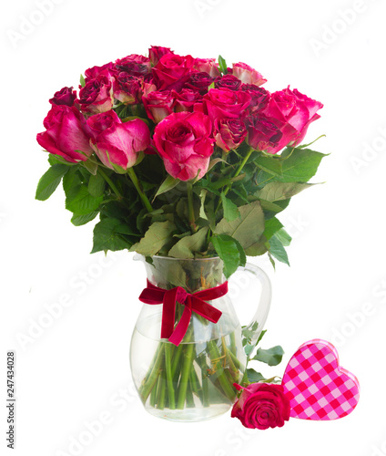 Leinwanddruck Bild bouquet of blossoming dark red roses in vase