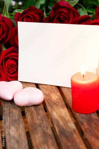 Two burning candles with fresh roses © neirfy