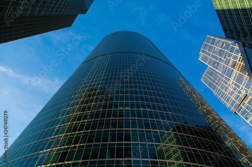 Moscow-City Mirrored skyscrapers business center. Over blue sky background.