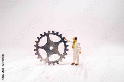 Businessman Pushing Creativity Gear - 247450231