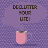 Text sign showing Declutter Your Life. Conceptual photo remove unnecessary items from untidy overcrowded place Mug photo Cup of Hot Coffee with Blank Color Speech Bubble as Steam icon - 247466646