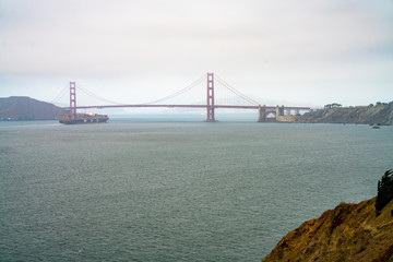 Golden gate bridge view in San Francisco. View through the fog.