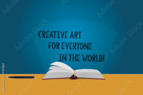 Handwriting text Creative Art For Everyone In The World. Concept meaning Spread creativity to others Color Pages of Open Book photo on Table with Pen and Light Beam Glaring © Artur