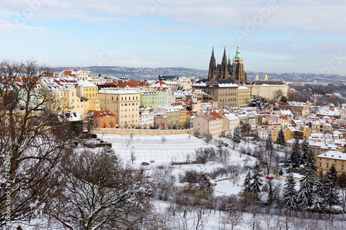 Snowy Prague City with gothic Castle from Hill Petrin in the sunny Day, Czech republic - 247476894