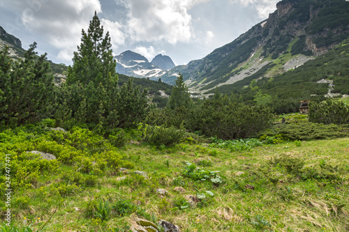 Landscape with dark clouds over Malyovitsa peak and Malyoviska river, Rila Mountain, Bulgaria - 247477471