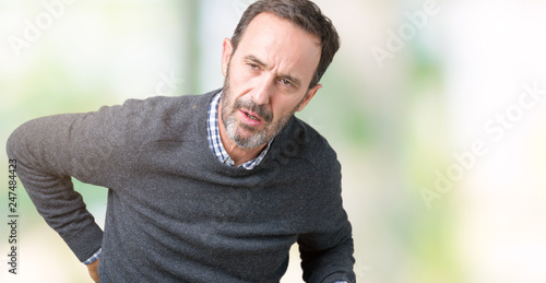 Leinwanddruck Bild Handsome middle age senior man wearing a sweater over isolated background Suffering of backache, touching back with hand, muscular pain