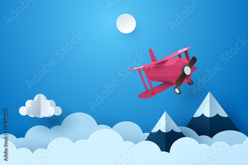 Paper art of plane flying through cloud at night, paper art concept and tourism idea
