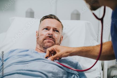 Doctor examinig a sick man