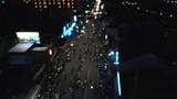 Aerial footage drone flying backward passing people crowd around Yogyakarta Monument or TUGU JOGJA at new year night - 247504249