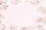 Flowers composition. Gypsophila flowers on pastel pink background. Flat lay, top view, copy space