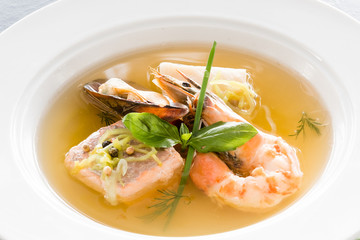 Restaurant shellfish menu. Fine cuisine. Seafood soup close up.