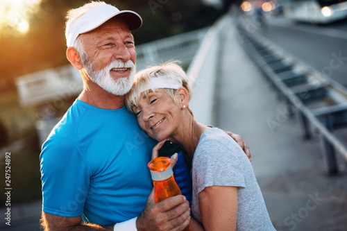 Leinwanddruck Bild Fitness, sport, people, exercising and lifestyle concept - senior couple running