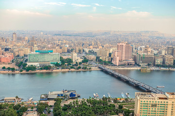 .11/18/2018 Cairo, Egypt, panoramic view of the central and business part of the city from the observation deck at the highest tower of the African capital at sunset © Alexeiy