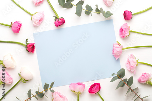 Foto Murales Beautiful colored ranunculus flowers on a white background.Spring greeting card.