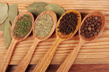 Spices in wooden spoons. Pepper, Coriander, Turmeric - 247535466
