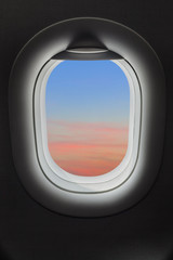 Sunset sky in airplane window