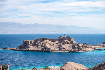Ancient military fort Salah El Din Citadel on a small island on the shores of the Red Sea