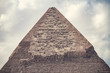 .Elegant view of the top of the pyramid of the cheops on a sunny day in the desert