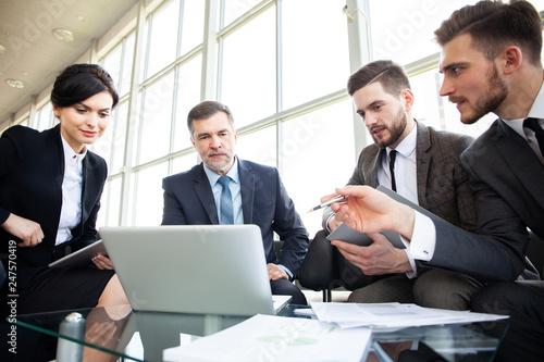 Leinwandbild Motiv Corporate business team meeting in a modern open plan office