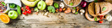 Healthy food. Selection of good carbohydrate sources, high fiber rich food. Low glycemic index diet. Fresh vegetables, fruits, cereals, legumes, nuts, greens. top view copy space banner