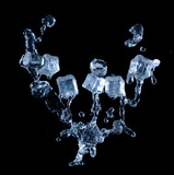 Ice cubes with water splashes on black background - 247597424