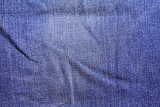 Denim. Crumpled blue jeans. Close-up. Background. Texture. - 247598896