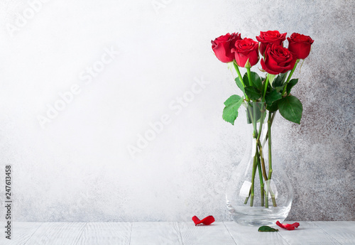 Leinwanddruck Bild Red rose flowers bouquet