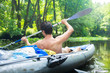 Man in kayak with oars. Kayaking on wild river. Active water sport on boat.