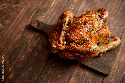 Homemade roasted spicy chicken with chilli and chive - 247623847