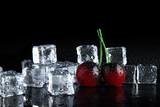 golden cherry frozen in ice on black background