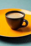 Cup of coffee on bright background