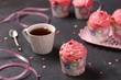 Homemade cupcakes with cream on a dark background. Concept for Valentine's Day, Birthday, March 8 and Mother's  Day