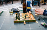 Adult people play chess game in a small town in Italy