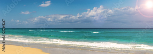 Tropical beach panorama at a sunny day - 247663267