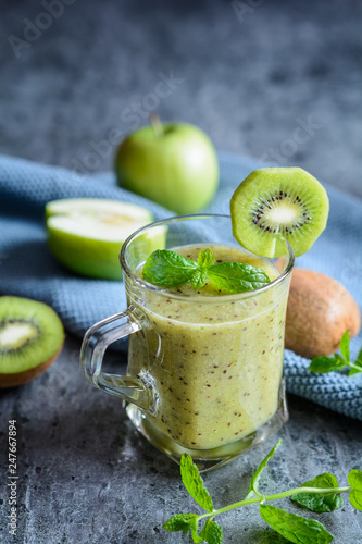 Apple smoothie with kiwi in a glass jar - 247667894