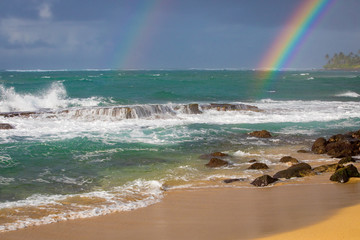 Rainbows on the beach in Hawaii