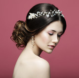 Beautiful model with bridal makeup and hairstyle