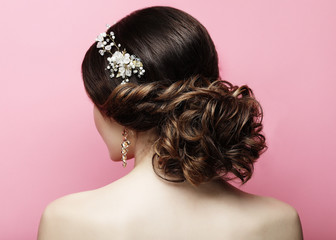 young woman with beautiful hairstyle and stylish hair accessory