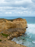 Rock cliff towards the vast ocean. Great Ocean Road, VIC, Australia.