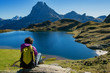 woman hiker sitting in the Pyrenees mountains near the Pic du Midi d Ossau