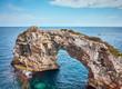 Es Pontas, a natural rock arch at Mallorca coast, Spain.
