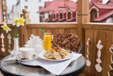 Sweet breakfast with coffee at the balcony with outdoor view - 247735899