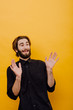 Picture of bearded man, holding his palms up near yellow wall. Emotions and gesture concept. Person tells his employer that it was not him